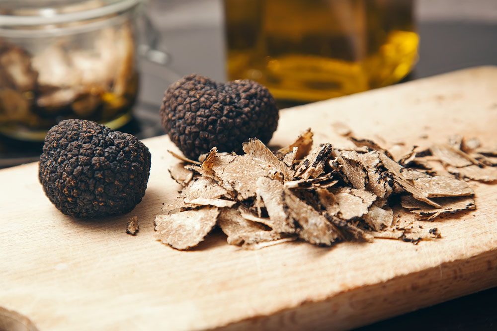 Truffles on wooden board