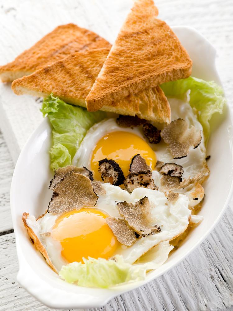 sunny eggs, toast, greenery black truffle slices